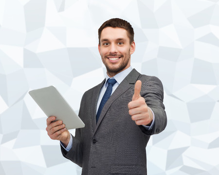 business, communication, modern technology and office concept - smiling businessman with tablet pc computer showing thumbs up over gray graphic low poly background