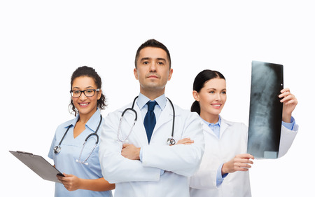 spine surgery: surgery, profession, people and medicine concept - group of medics with x-ray