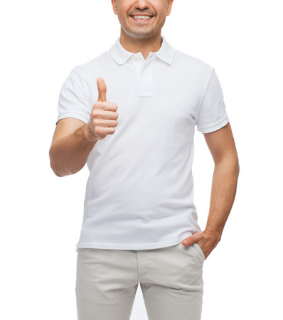 polo t shirt: happiness, gesture and people concept - smiling man showing thumbs up