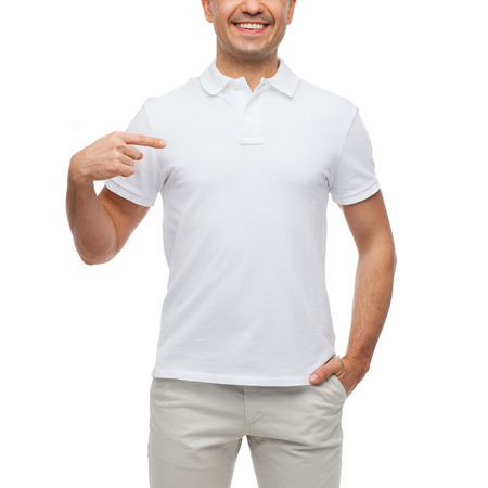 middle age man: happiness, advertisement, fashion, gesture and people concept - smiling man in t-shirt pointing finger on himself