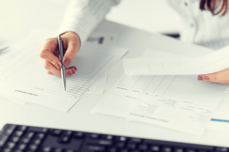 picture of woman hand filling in blank paper or document