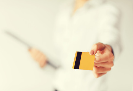 membership: business, luxury, shopping and money concept - woman showing gold credit card