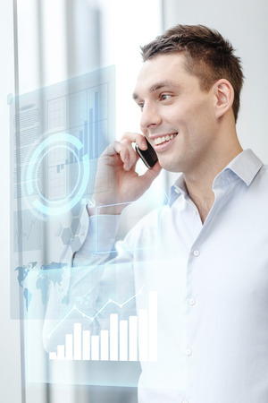 business, technology and office concept - smiling businessman with smartphone in office photo
