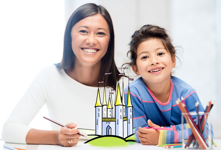 people, family, childhood, creativity and leisure concept - happy mother and daughter drawing fairytale castle at home photo