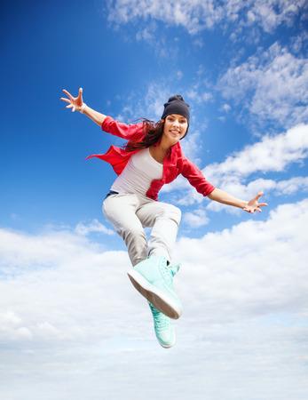 urban culture: sport, dancing and urban culture concept - beautiful dancing girl jumping