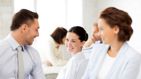 co work: smiling business team discussing something in office
