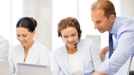 headset business: picture of group of people working in call center or office