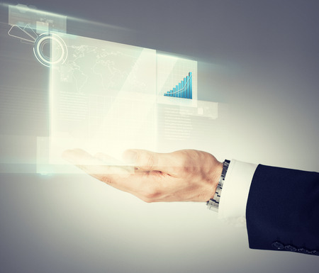 business and finances - businessman hand showing raising chart on virtual screen photo