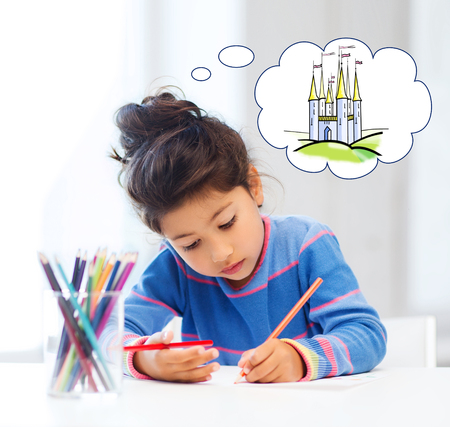 imagination: people, childhood, creativity and imagination concept - happy little girl drawing with crayons and dreaming about fairytale castle at home or art school