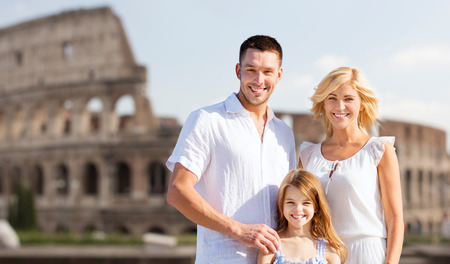 summer holidays, travel, tourism and people concept - happy family in rome over coliseum background