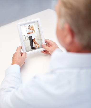 oldness: oldness, memories, nostalgia and people concept - close up of old man holding and looking at happy young couple photo