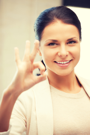 yuppie: bright picture of lovely teenage girl showing ok sign