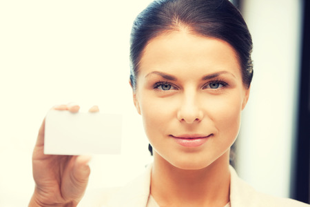 bright picture of confident woman with business card Stock Photo