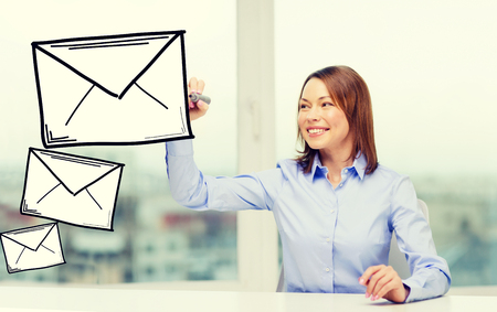 letter envelope: office, business, technology concept - businesswoman drawing envelope on virtual screen Stock Photo