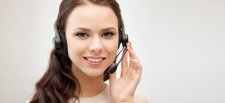 call center female: business and office concept - friendly female helpline operator with headphones