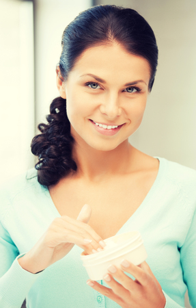 creme: picture of beautiful woman with moisturizing creme