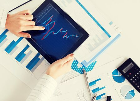 forex: business, office, school and money concept - woman with chart paper, tablet pc and forex chart in it Stock Photo