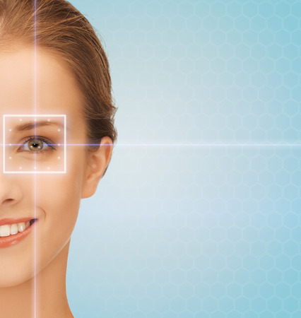 laser focus: health, medicine, identity, vision and people concept - smiling beautiful young woman with laser light lines on her eye over blue background