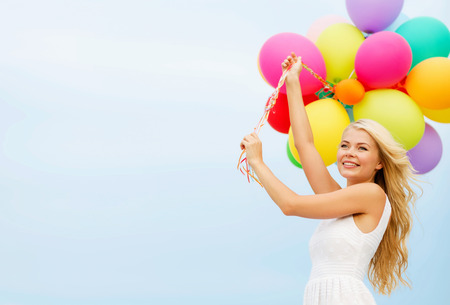anniversary beach: summer holidays, celebration and lifestyle concept - beautiful woman with colorful balloons outside