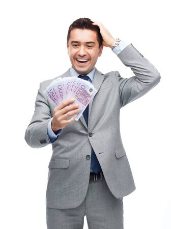 business, people and finances concept - happy laughing businessman with euro money