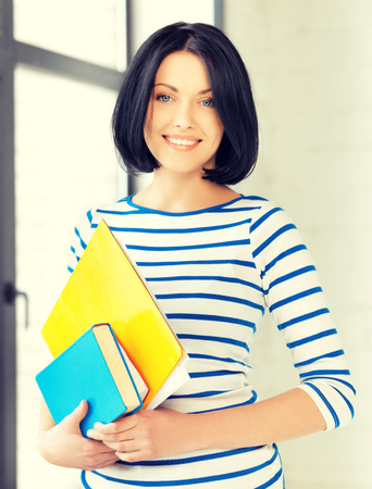 simple girl: picture of smiling student with books and notes Stock Photo