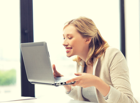 remote access: bright picture of happy woman with laptop computer