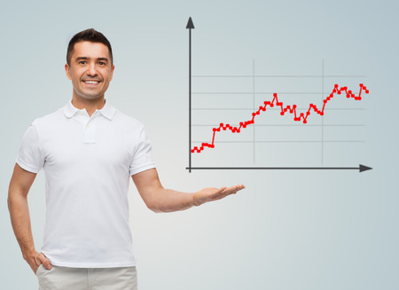 business, statistics, economics, success and people concept - smiling man showing growing chart over gray background photo