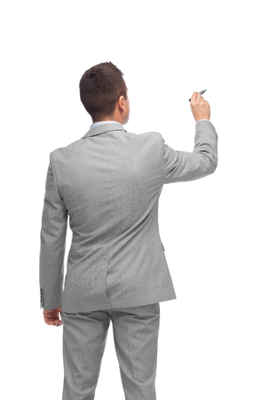 nothing: business, people, advertisement , information and office concept - businessman writing or drawing something imaginary from back