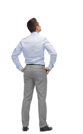business, people, rear view and office concept - businessman looking up from back 스톡 콘텐츠