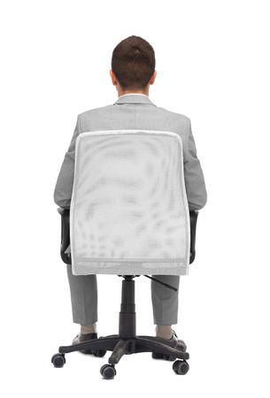 back view of man: business, people, furniture, rear view and office concept - businessman sitting in office chair from back Stock Photo