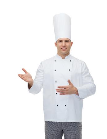invitando: la cocina, la profesi�n y la gente concepto - feliz masculino atractivo cocinero cocinero