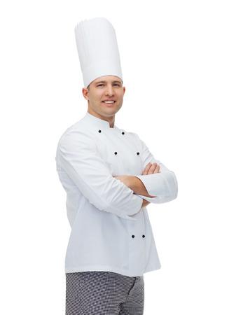 料理、職業や人のコンセプト - 幸せな男性シェフの交差させた手