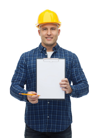 repair, construction, building, people and maintenance concept - smiling male builder or manual worker in helmet with clipboard photo