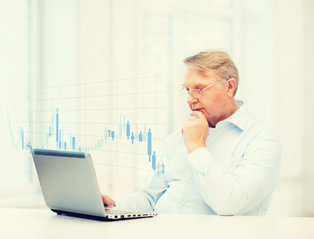 oldness: technology, money, oldness and business concept - old man in eyeglasses with laptop computer and forex chart at home
