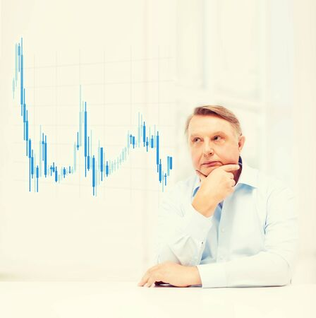 oldness: oldness, business, money and people concept - stressed old man with forex chart holding head at home