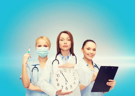 timezone: healthcare and medicine concept - calm female doctor and nurses with wall clock and stethoscope