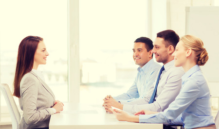 applicant: business, career and office concept - smiling businesswoman at job interview in office