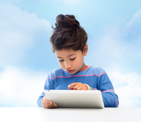 education, technology and children concept - little student girl with tablet pc over blue sky background