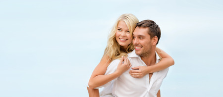 holiday summer: summer holidays, celebration and dating concept - couple at seaside