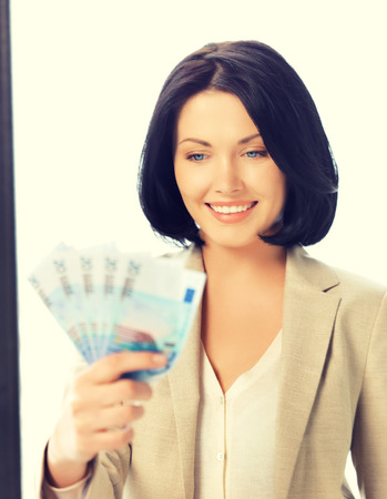 cash money: bright picture of lovely woman with euro cash money