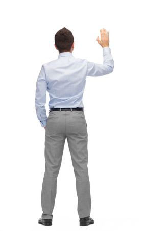 hi back: business, people, gesture and office concept - businessman waving hand or touching something imaginary from back