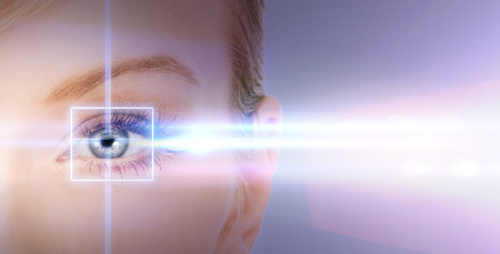 health, vision, sight - woman eye with laser correction frame Фото со стока