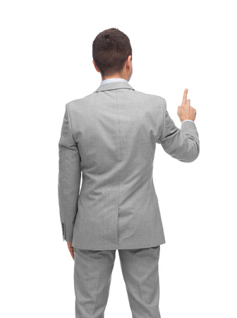 imaginary: business, people, advertisement and office concept - businessman pointing finger or touching something imaginary from back