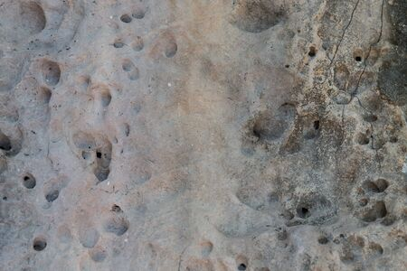 stone volcanic stones: background, design and texture concept - relief volcanic stone texture