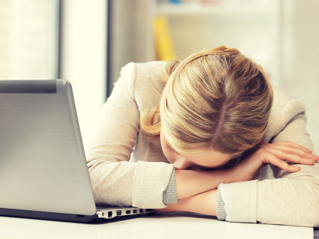 to the secretary: picture of tired woman with laptop computer