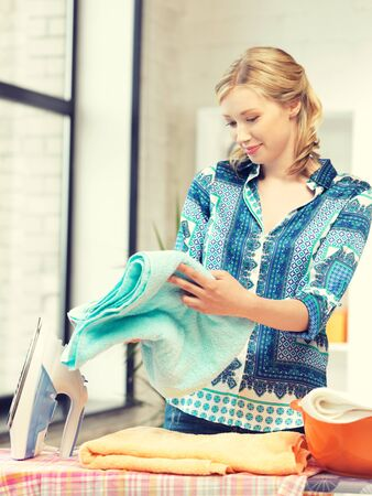 bright housekeeping: bright picture of lovely housewife with iron.