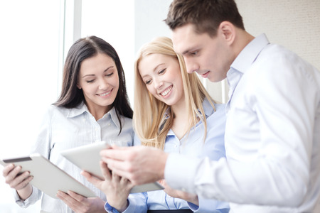 business and office concept - smiling business team working with tablet pcs in office Stock fotó - 40249570