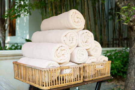 towels luxury: luxury and hygiene concept - rolled bath towels at hotel spa