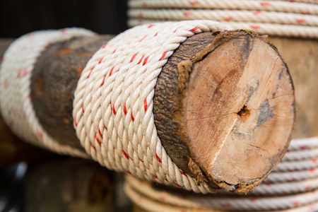 coiled rope: building, construction and eco concept - wooden beam wrapped with rope