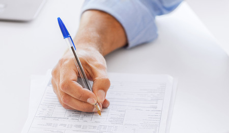 municipal utilities: business, office, school and education concept - man filling tax form